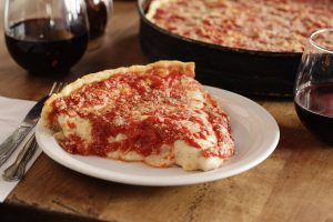 Slice of Lou Malnati's deep dish pizza
